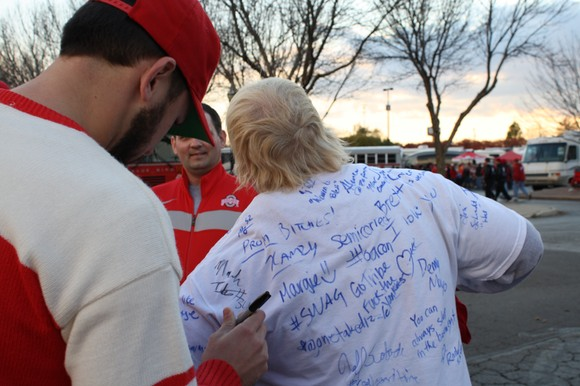 Titus signs @Bleez17's shirt.