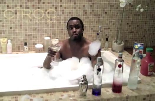 I think my favorite thing about this picture -- besides hotelesque tiling and way too many lotions for a man's shower -- is the jug of juice on Diddy's left. AND WHO IS TAKING THIS PICTURE??? (((***realize it's three naked girlz****)) ..... Touché, as always, Diddy. Touché.