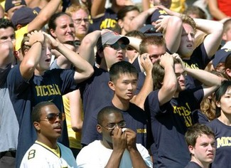 Michigan fans react in shock to something or other.