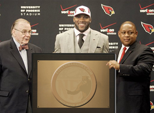 Beanie receives his award at the Cardinals Facility.