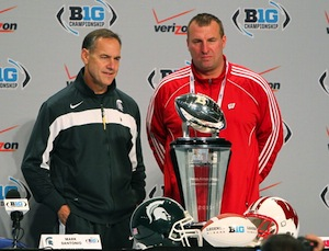 To be fair, Dantonio is sort of smiling in this picture, though it looks to be a painful ordeal for him.