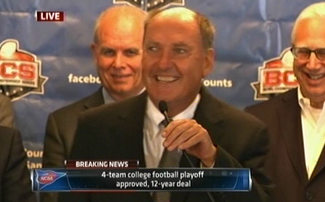 Jim Delany smiles for the first time ever after announcing a four team playoff