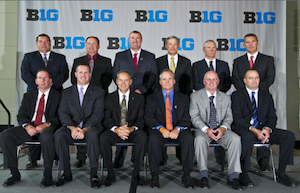 I'm 99.9% sure that Brady Hoke is trying to suck in his gut in this picture.