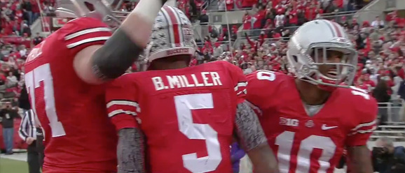 Tackle Reid Fragel, quarterback Braxton Miller and receiver Corey Brown hold a group celebration after Miller scored on a two yard touchdown.