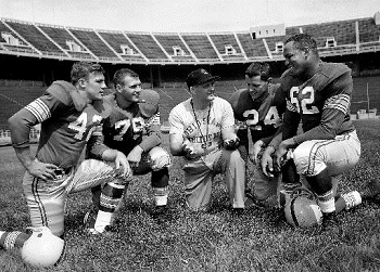 From left to right: Hubert Bobo, Bill Michael, Coach Woody Hayes, Frank Ellwood and Jim Parker