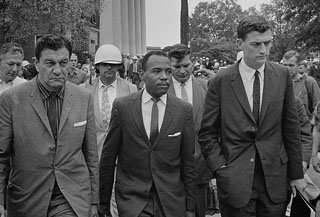 James Meredith, shown being escorted to class at Ole Miss