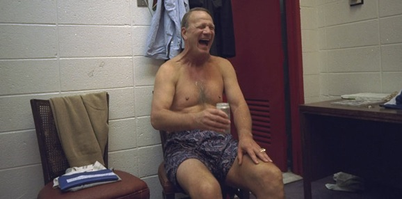 Barry Switzer enjoys a cold one in the locker room