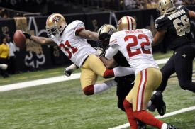 Donte Whitner scored one of two TDs for the Niners defense.