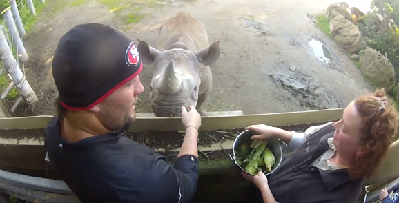 Alex Boone with the rhino named after him at the SF Zoo.