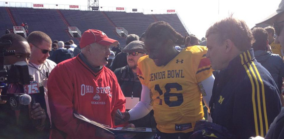 Michigan's Denard Robinson signs something for an Ohio State fan. But what?
