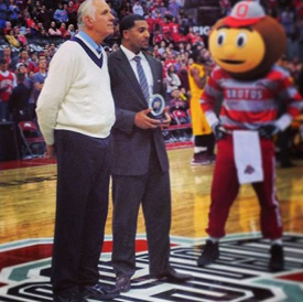 Jim Jackson presents Jerry Lucas with the NCAA Tournament Top 75 Player award Wednesday.