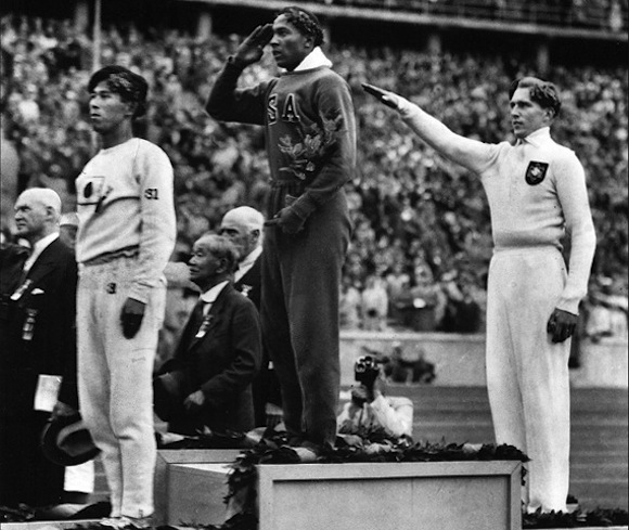 Ohio State's Jesse Owens collects another gold medal at the 1936 Berlin Olympics