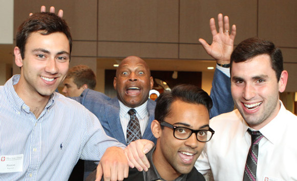 Archie Griffin photobombing students at graduating senior toast night.
