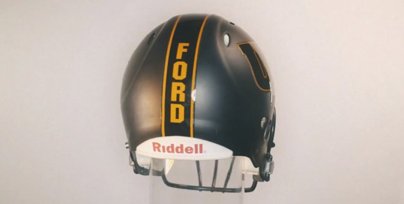 Findlay's new football helmet feature player names on the back.