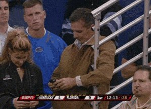 Urban Meyer checking his phone for the latest tweets from @11W