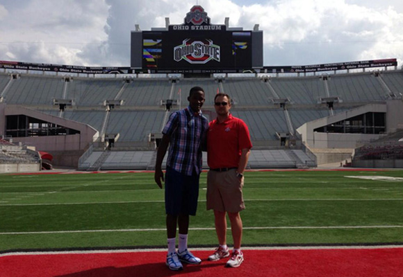 Four-star quarterback Brandon Harris and Ohio State offensive coordinator Tom Herman pose in the Horseshoe