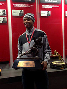 Lonnie Johnson Holds The Heisman Trophy