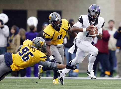 WVU's Korey Harris reaches for a tackle against a TCU player.