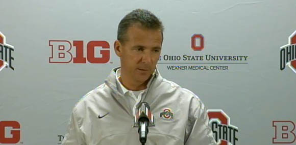 Urban Meyer holds court.