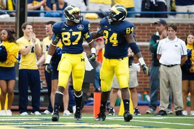 Oct 5, 2013; Ann Arbor, MI, USA; Michigan Wolverines tight end Devin Funchess (87) receives congratulations from tight end A.J. Williams (84) after making a catch against the Minnesota Golden Gophers at Michigan Stadium. / Rick Osentoski-USA TODAY Sports