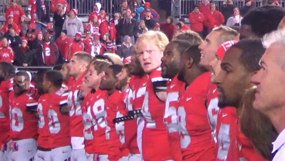 Ohio State football players sing Carmen Ohio following the 63-14 win over Penn State.