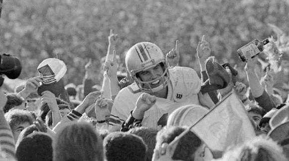 Art Schlichter celebrates with the Buckeye faithful while at least one spectator is soaking in the spirits.