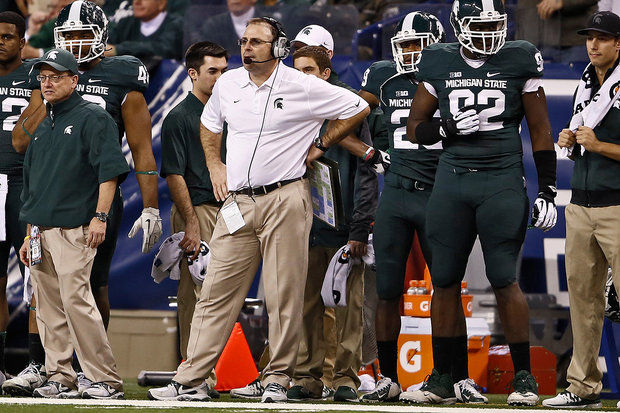Michigan State defensive coordinator Pat Narduzzi came down to the sideline in the third quarter, in an attempt to fire up the Spartans. (Mike Mulholland | MLive.com)