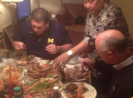 Brady Hoke eating stuff that's probably not healthy and should raise his cholesterol level because he's irreponsible like most Michigan Men.