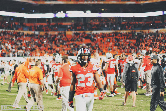Tyvis Powell walks off the field after the 2014 Orange Bowl