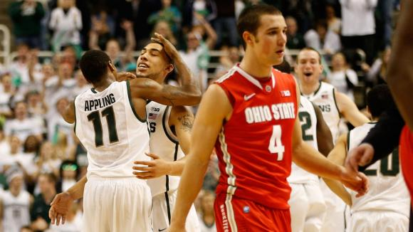 Michigan State players celebrate a win over Ohio State.