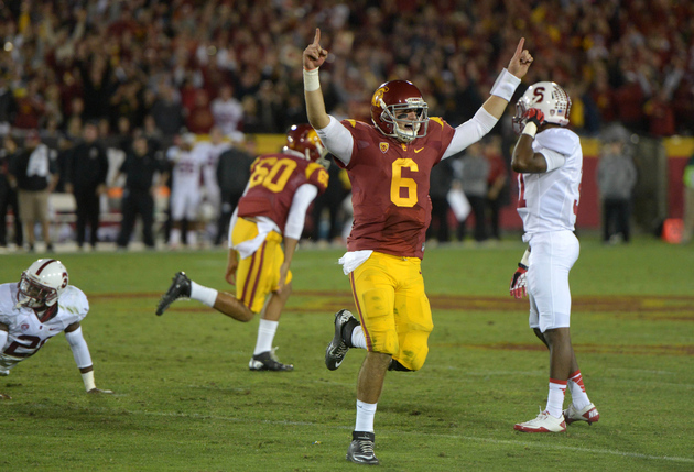 Cody Kessler celebrates against Stanford in 2013.