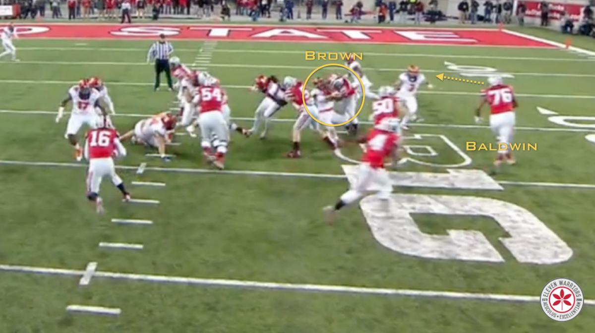 Brown crushes a linebacker while Baldwin looks downfield