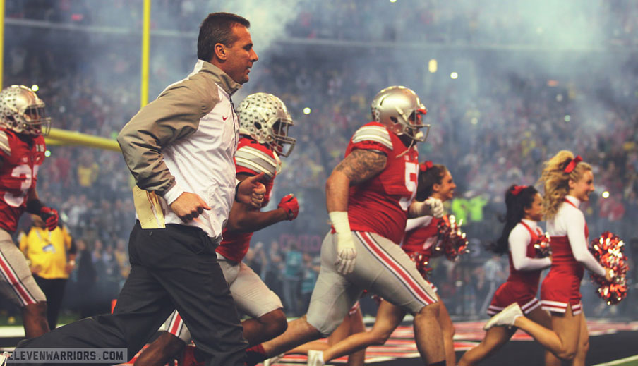Urban Meyer leads his Buckeyes on to the field at the National Championshipo.