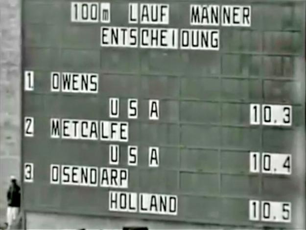 owens wins the 100m