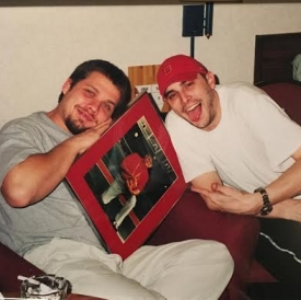 My brother, Woody and me drunkenly celebrate the double-OT defeat of Miami in a dingy hotel room near Hampton, VA.