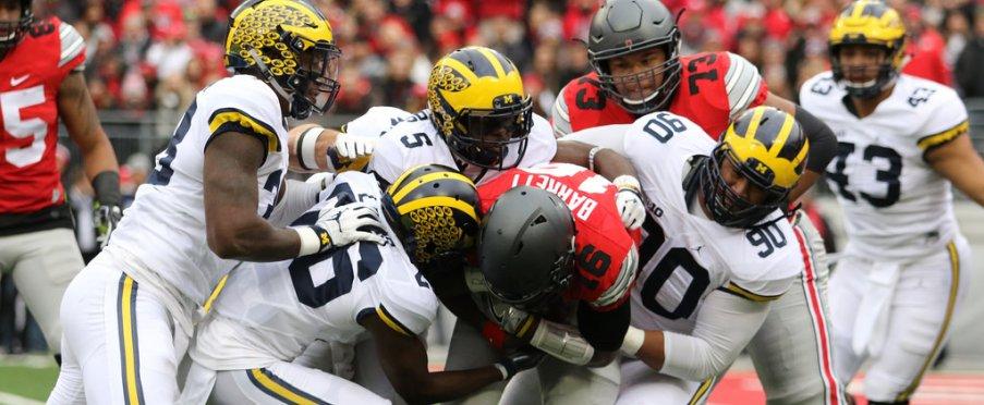 Ohio State's shaky pass protection led to eight Michigan sacks.