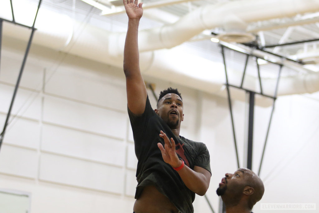 Jared Sullinger shoots over Dallas Lauderdale during The Basketball Tournament practice.