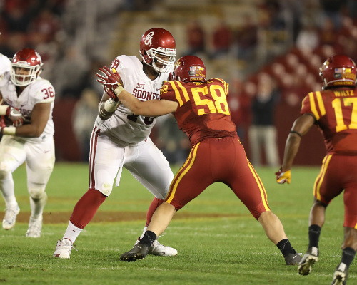 Nov 3, 2016; Ames, IA, USA; Oklahoma Sooners offensive tackle Orlando Brown (78) blocks Iowa State Cyclones defensive end Mitchell Meyers (58) at Jack Trice Stadium. Oklahoma beat Iowa State 34 to 24. Mandatory Credit: Reese Strickland-USA TODAY Sports