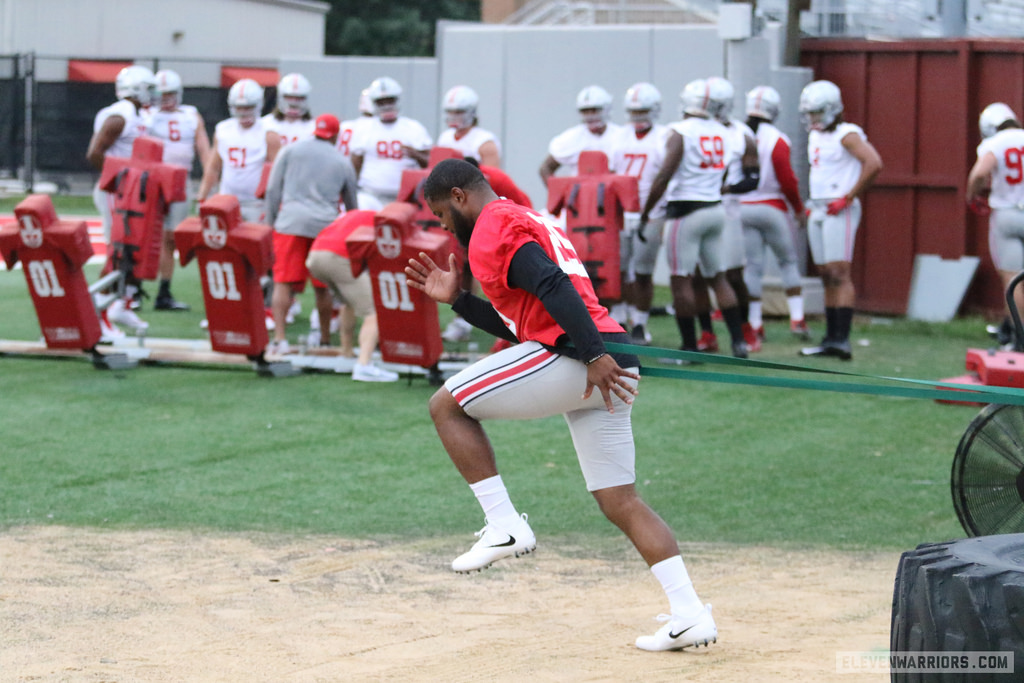 Mike Weber working out with an athletic trainer during the first practice of fall camp.