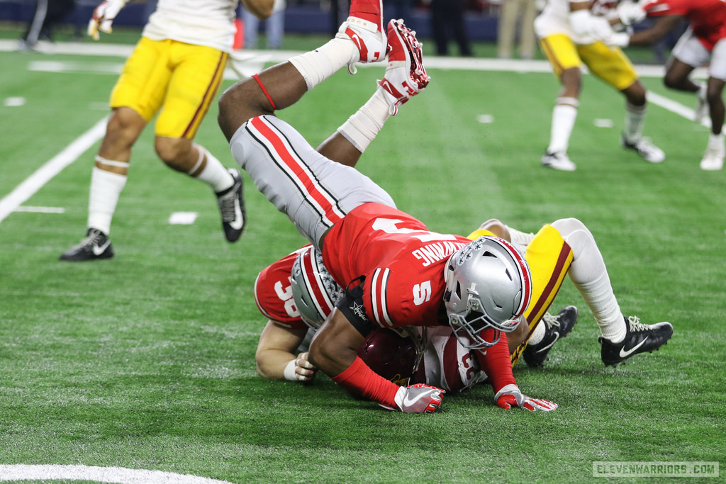 Baron Browning assists on a tackle in the Cotton Bowl