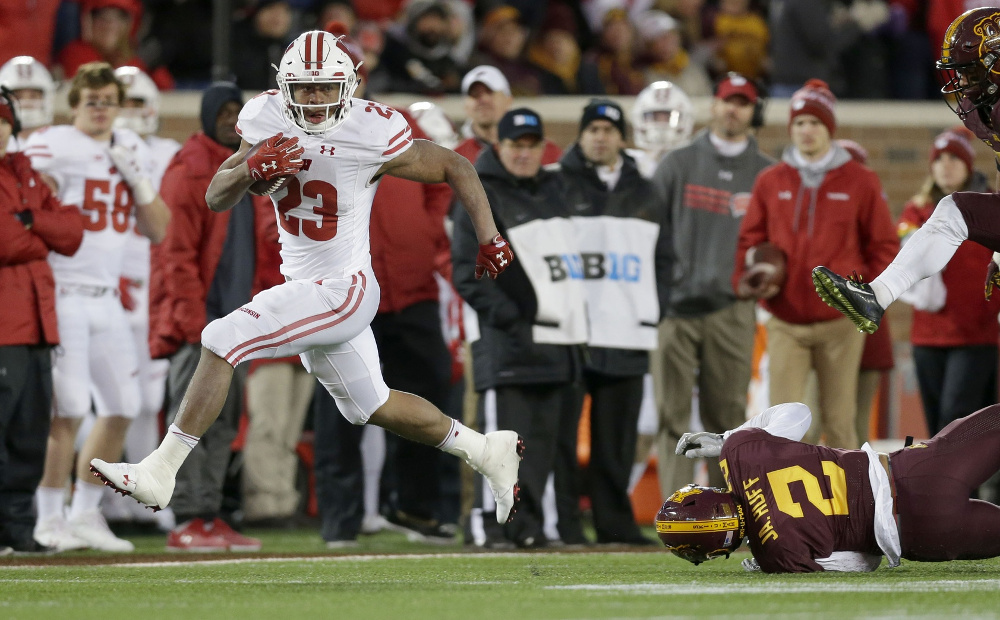Nov 25, 2017; Minneapolis, MN, USA;  Wisconsin Badgers running back Jonathan Taylor (23) scores a long touchdown during the fourth quarter of the Badgers 31-0 win over the Minnesota Golden Gophers at TCF Bank Stadium. Mike De Sisti/Milwaukee Journal Sentinel via USA TODAY NETWORK
