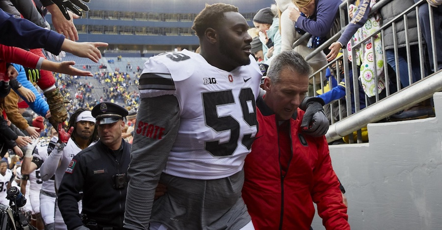 Nov 25, 2017; Ann Arbor, MI, USA; Ohio State Buckeyes offensive lineman Isaiah Prince (59) and head coach Urban Meyer walk off the field after defeating the Michigan Wolverines 31-20 at Michigan Stadium. Mandatory Credit: Rick Osentoski-USA TODAY Sports