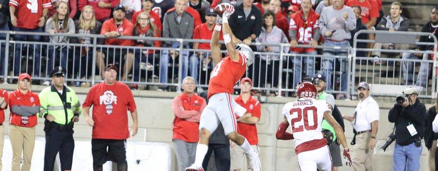 Austin Mack high-points the football against Oklahoma.