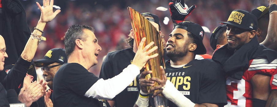 Ezekiel Elliott hold the trophy.
