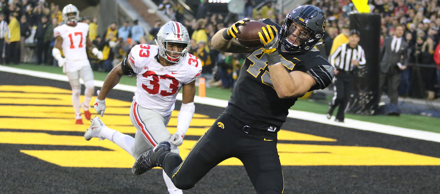 Dante Booker gives up a touchdown catch to Iowa's Drake Kulick.