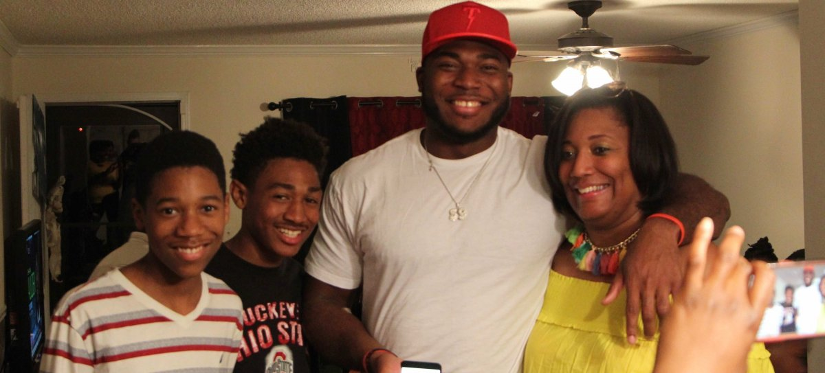 Tyquan Lewis celebrates his selection with loved ones.