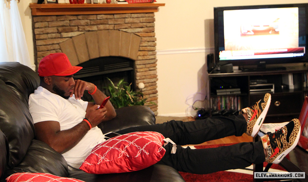 Tyquan Lewis on his family's couch as he waits for his name to be called in the NFL Draft