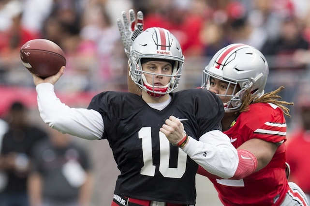 Apr 14, 2018; Columbus, OH, USA;Gray Team quarterback Joe Burrow (10) sends a pass upfield under pressure from Scarlet Team defensive end Chase Young (2) during the Spring Game at Ohio Stadium. Mandatory Credit: Greg Bartram-USA TODAY Sports