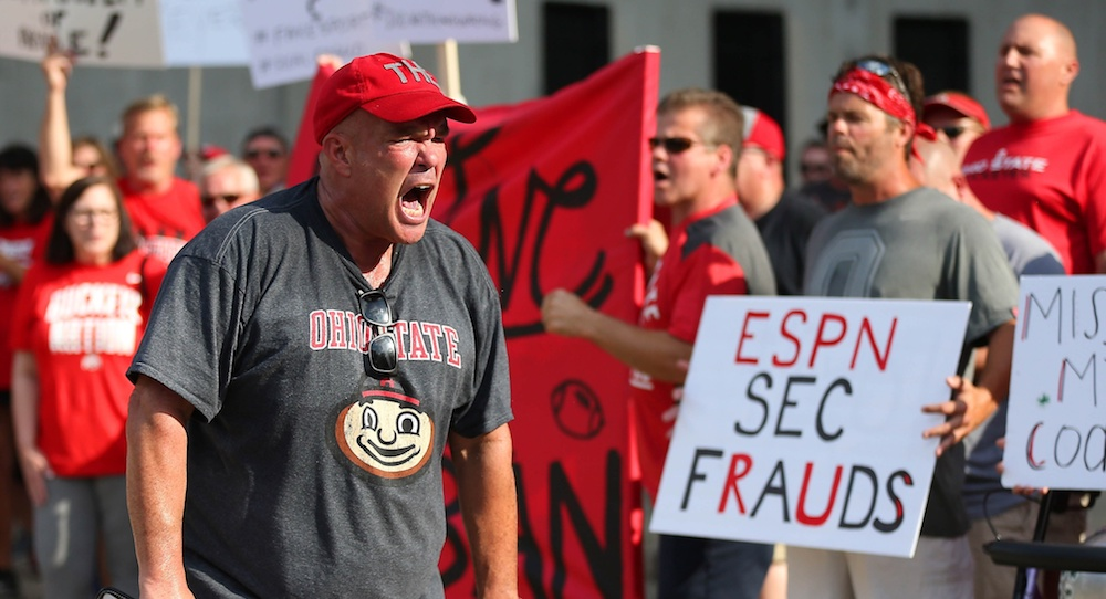 Aug 6, 2018; Columbus, OH, USA; Jeff Hamms leads the rally in support of Ohio State Buckeyes coach Urban Meyer at a rally held at Ohio Stadium on Monday at The North Rotunda. Mandatory Credit: Joe Maiorana-USA TODAY Sports