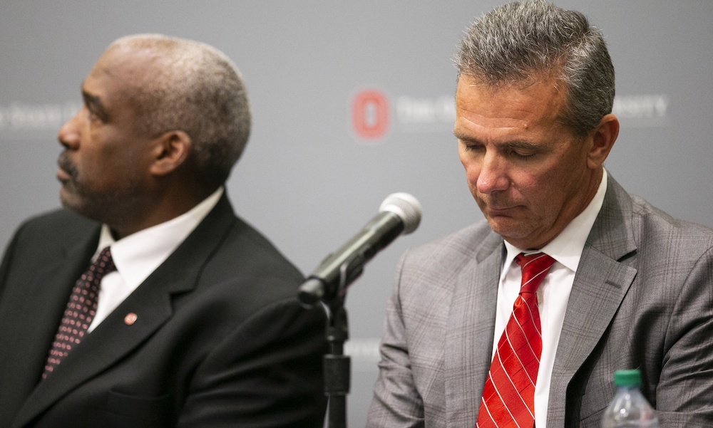 Aug 22, 2018; Columbus, OH, USA; Ohio State Buckeyes head coach Urban Meyer (right) listens as university president Michael Drake speaks at Longaberger Alumni House on the Ohio State University campus. Mandatory Credit: Greg Bartram-USA TODAY Sports